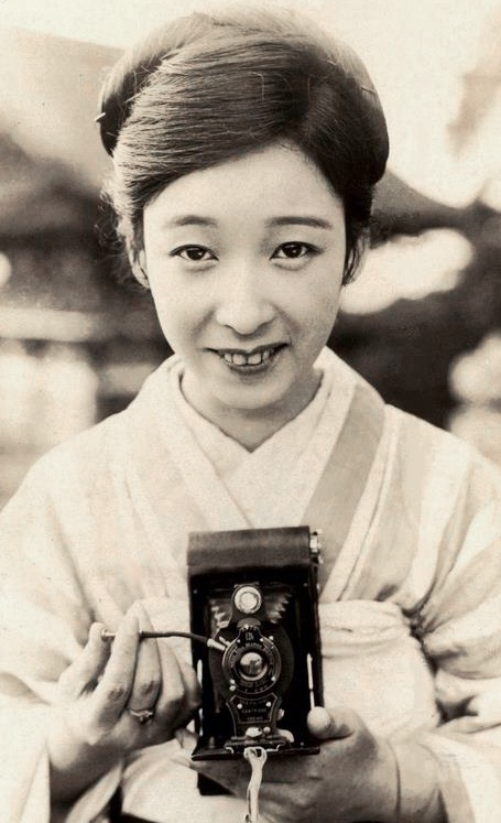 Young kimono-clad lady with early camera.  Photo likely taken in the 1920's, Japan.  Photographer Kazumasa Ogawa