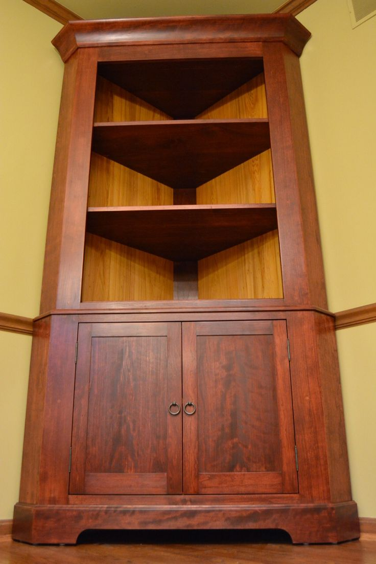 """Shaker corner cabinet made from stained cherry and redwood. Frame and panel doors, all solid hardwood construction. 85"""" x 42"""" x 24"""""""