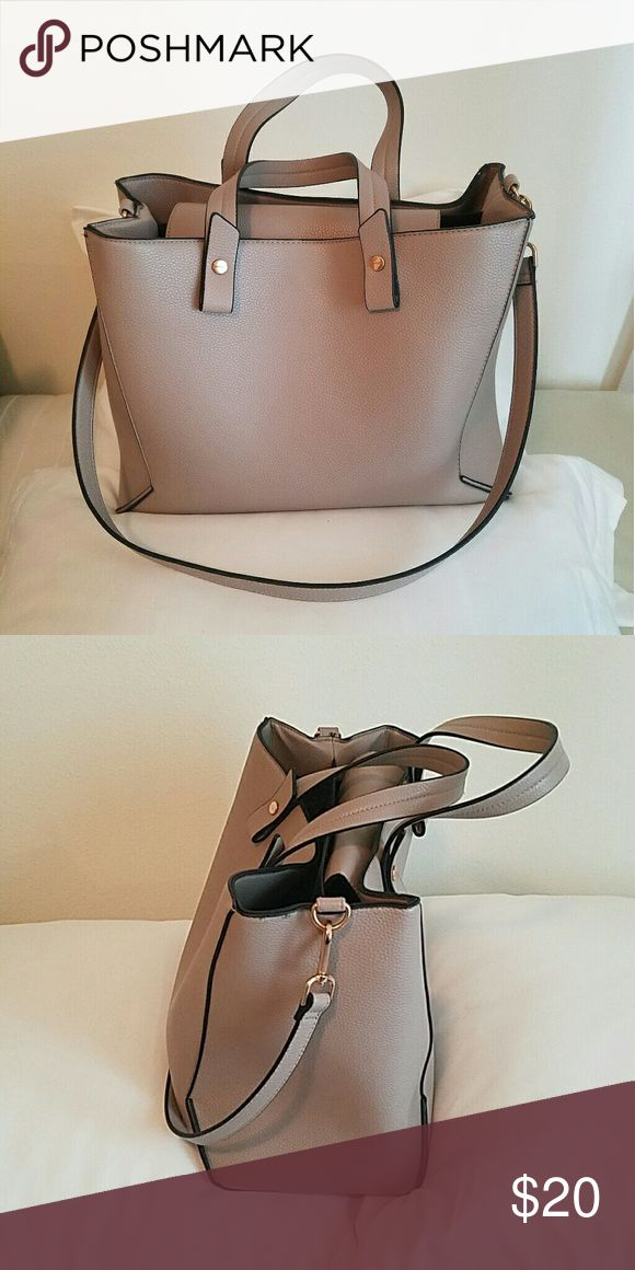 H&M Tan Handbag H&M Tan Handbag! The inside is black with a divider in the middle. It has a pocket for a cell phone and other one for small accessories.  It would be a great travel bag! H&M Bags Travel Bags