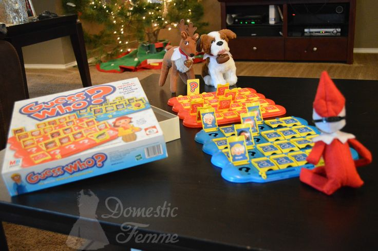 Reese and the Elf Pets play Guess Who board game - FREE Elf On The Shelf Calendars, Printables and over 100 Ideas! #Arrival #Christmas #Clothes #Costume #Day #Easy #Elves #Eve #Fast #Food #First #Funny #Girl #Good #Goodbye #Hiding #Hilarious #Holiday #Jesus #Jokes #Kid #Kindness #Lazy #Magic #Minutes #Mischief #Moms #Movie #Moving #Night #Old #Pajamas #Pet #Photos #Pictures #Planner #PJs #Pranks #Quick #Reindeer #Return #Returning #Toddlers #Tradition #Tricks #Video #Xmas #Year #Young