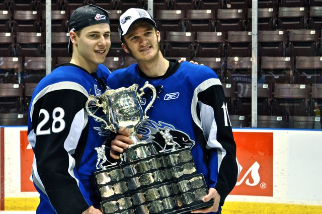 Nathan Beaulieu (Montreal Canadiens prospect) and Jonathan Huberdeau (Florida Panthers prospect) pose with the Memorial Cup. Photo credit to Justin Fisher.