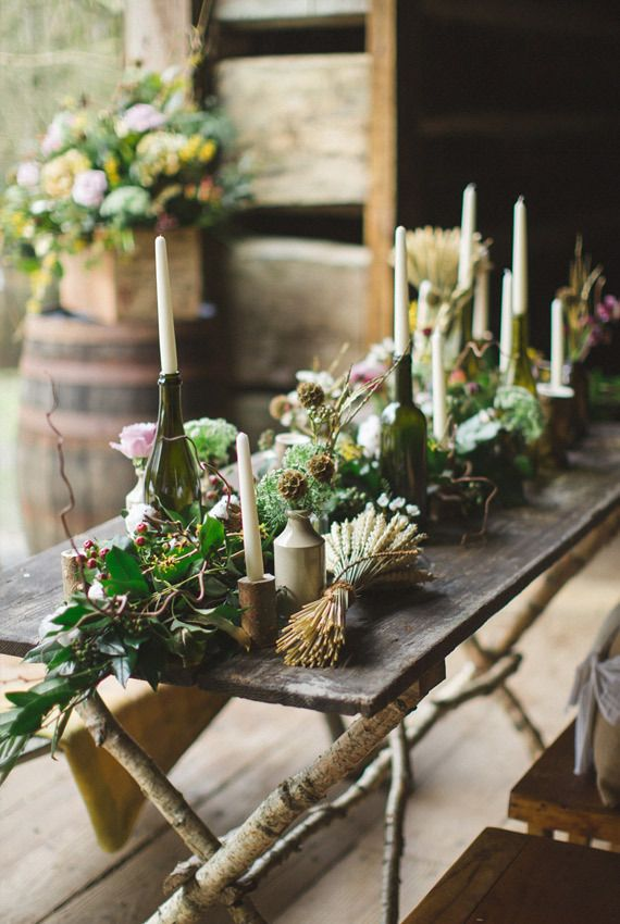 Candles, moss and greens for an inspired woodlands table setting