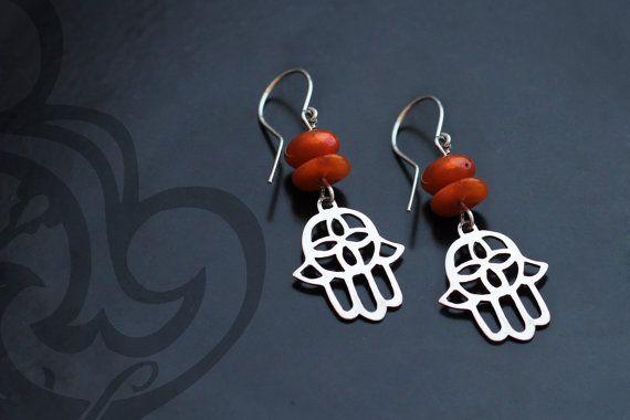 Silver hamsa earrings with baltic amber