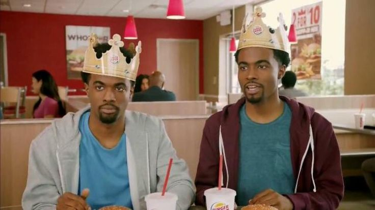 As two brothers enjoy their Burger King Whoppers, one man talks about being surprised by the price of the 2 for $10 Whopper Meal deal. Now the twins can eat their burgers together while wearing Burger King crowns.