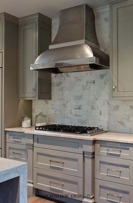 light taupe kitchen; stainless steel range hood