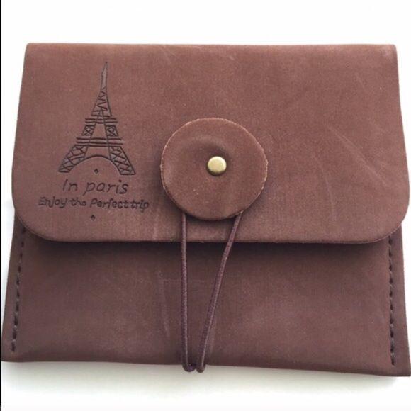 """Paris Theme Pouch Small, faux sued pouch features Eiffel Tower above inscription, and elastic loop closure. Rich brown color exterior. Approximately 4"""" x 4 1/2"""" across. Image 4 shows pouch atop legal size envelope for size comparison. This is a small pouch, please note dimensions and scale in image 4. Brand new without tags. No trades, no holding, no offsite payment.      ❗️PRICE IS FIRM UNLESS BUNDLED❗️ Accessories"""