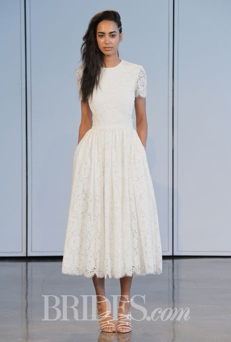 Brides.com: Houghton - Spring 2015. Wedding dress by Houghton. Modest tea length short sleeves
