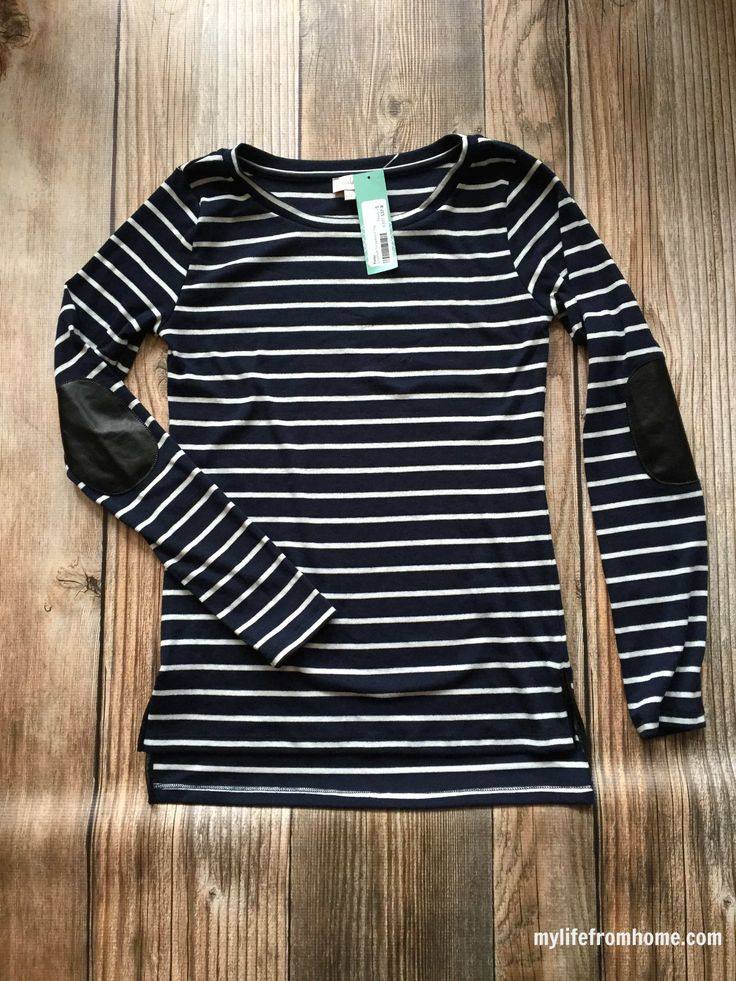 I LOVE this shirt from Stitch Fix! The narrow stripes and elbow patches are right up my alley. I would need a bright pop of color (colored pants, a great scarf, accessories, etc) though.    Pixley Greenich Striped Knit Top