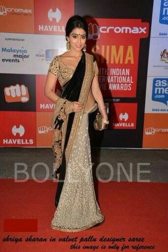 White net saree with black velvette pallu and heavy embroidery