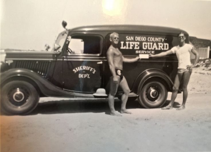 1st San Diego County Lifeguard Capt Bill Ramsey showing the $1200 check to start the service in 1941.(1935 Ford panel truck)