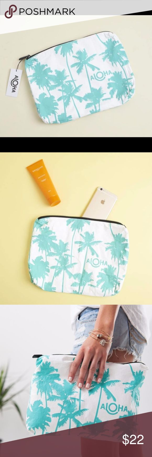 "Aloha Wet Dry Bag Brand new in packaging. Super cute! I live in sunny Seattle. I know someone else would be able to enjoy this gem more than I will. From Popsugar box June 2017. Take a little Kauai with you on your next adventure! This print was inspired by Kauai's coco palms and the famous Coco Palms Resort. This pouch is perfect to use as a beach clutch. Stow your sunscreen, sarong, and bikini, or pack toiletries for your next trip!  Mid-size pouch measures: 11.5"" across x 2"" wide x 8.5""…"