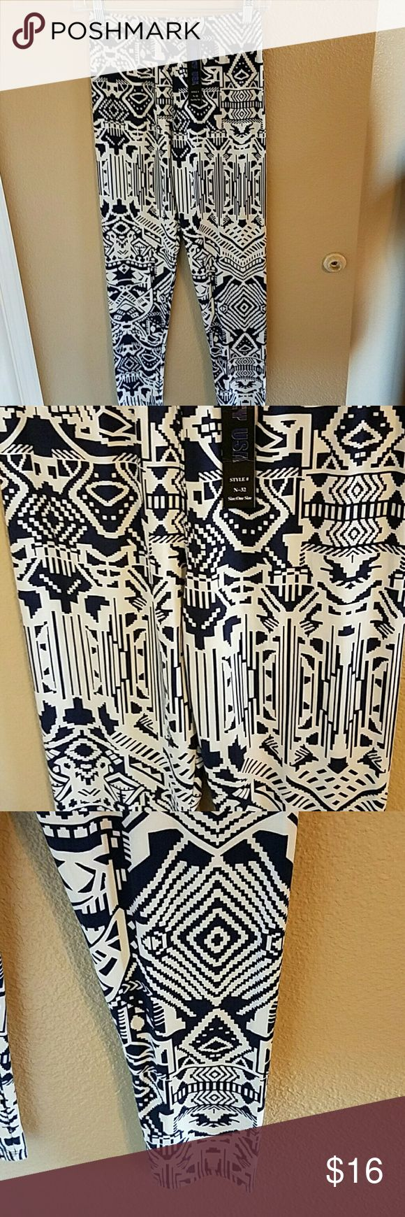 NWT Navy and White Stretchy Leggings NWT Adorable Aztec Navy Blue and White Leggings One Size fits Most. Extremely Soft and Stretchy with and Elasticized Waist Band. Purchsed from the amazing closet of scanon Boutique  Pants Leggings