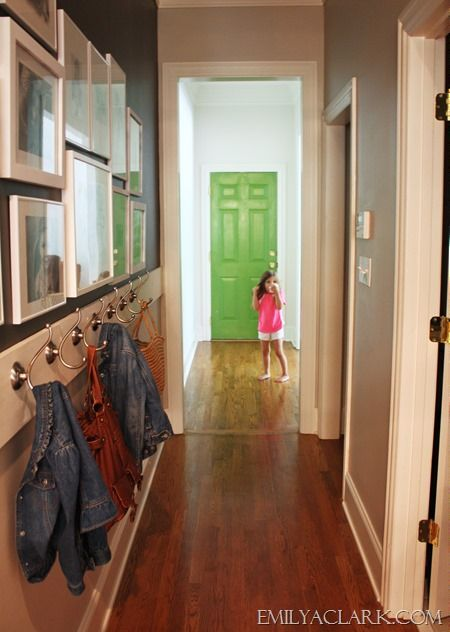 I chose this image because of the bright pop of green at the end of the hallway. The bright color draws the eye towards the end of the hallway and creates a focal point. The coat hooks on the wall provides quick storage and is appropriate for both children and adults