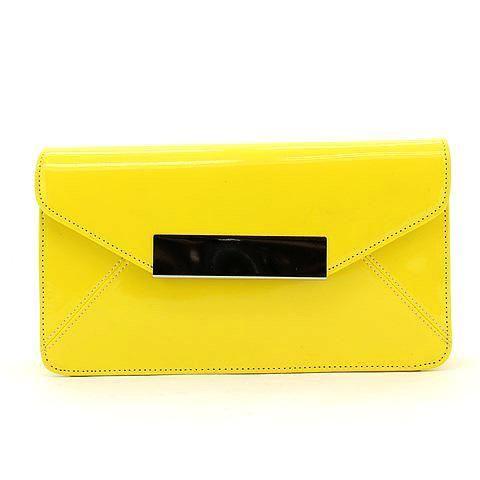 WANDERLUST clutch in yellow. #mybetsonBetts #BettsRaceDayReady #BettsShoes