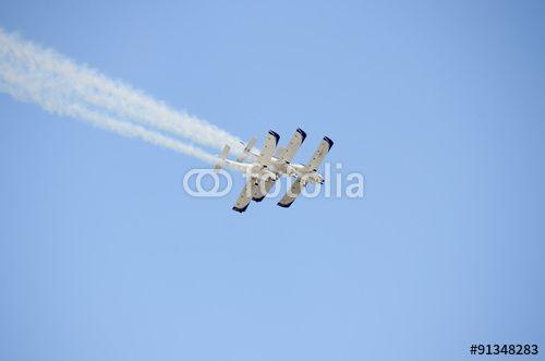 three very close aerobatic stands planes smoke tails