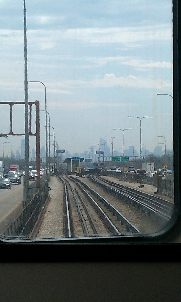 On the subway train heading to the airport with the big buildings of the city of Chicago in the distance