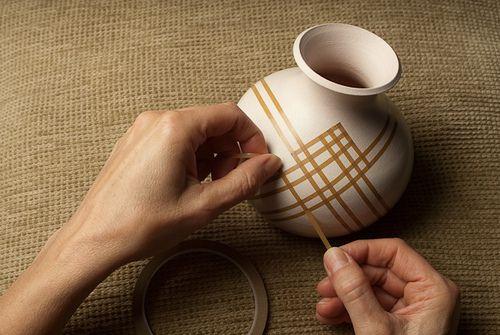 Taping A Pattern | Flickr - Photo Sharing! Lori Duncan. Amazing raku pieces! ceramic. glaze.