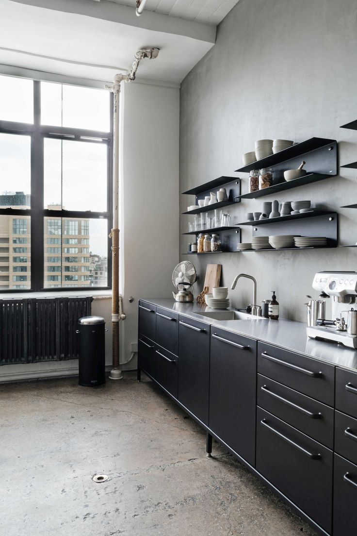 Modularity in Manhattan - a black Vipp kitchen and shelving units overlooking Soho