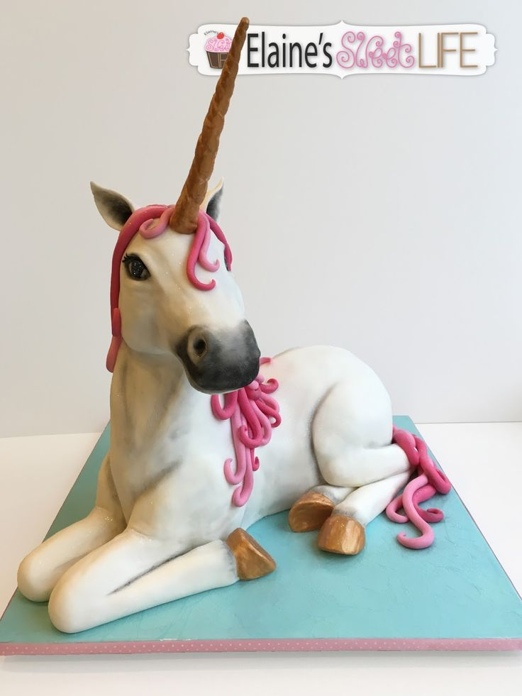 3D Sculpted Unicorn Cake - A white Unicorn with pink mane and tail; and golden horn and hooves.