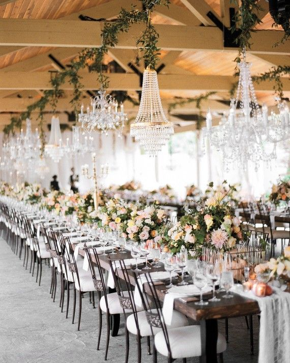 Whether you choose to do so with your lighting, florals, escort cards, or ceremony canopy, hanging wedding décor is an easy and seriously elegant way to make a statement at your wedding reception or ceremony. From grand chandeliers to pretty paper lanterns, get inspired by the hanging decorations at these weddings.