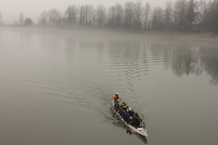The Fort Langley Canoe Club out in a Dragon Boat in the fog on the Fraser River.