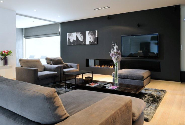 Schellen - Big tv next to fireplace