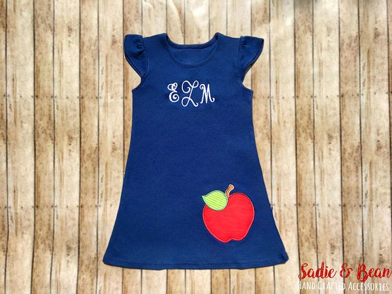 Tags: Monogrammed Girls Dress, Ruffle Dress, girls monogram, Back to school, back to school dress, Monogram, Dress, Baby, toddler, apple dress  This beautiful flutter dress is a great staple for school for any girl! It has such girly details with ruffles on the sleeves and lets not forget the finishing touch of the monogram and apple.   *Shown: Navy Dress on size 6X  Please Include in Notes at checkout: ------------------------------------------- 1. Thread Color 2. Monogram 3. Optional…