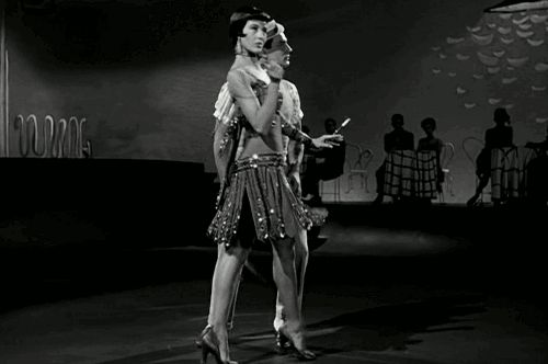 From the 'Broadway Melody Ballet' sequence in 'Singin' in The Rain,' MGM, 1952, Cyd Charisse with Gene Kelly.