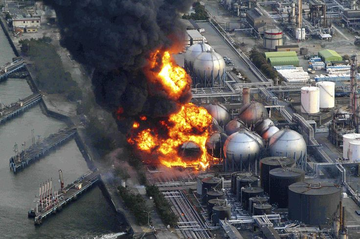 Quake-damaged, natural-gas storage tanks burn at the Cosmo oil refinery in Ichihara city, Chiba Prefecture, near Tokyo, on March 11, 2011
