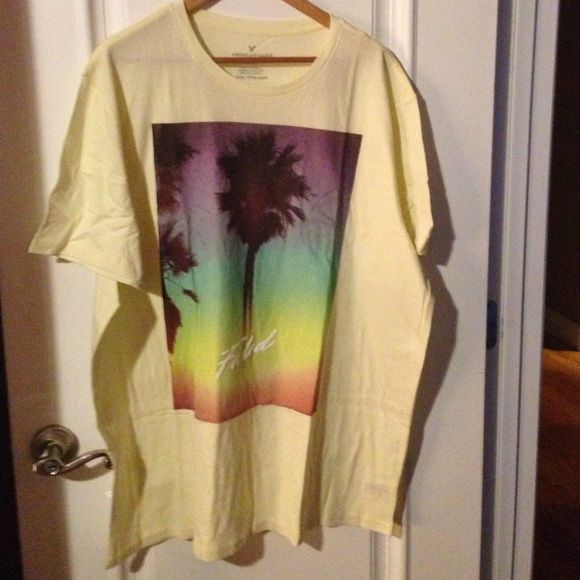 reduced T-shirt American Eagle American Eagle outfitters men's size XXX/TTTG/XXXG T-shirt, color lemon yellow , brand new with tag, short sleeve ❤️,open to any reasonable offer ☺️. Ask me about bundles ☺️ American Eagle Outfitters Tops