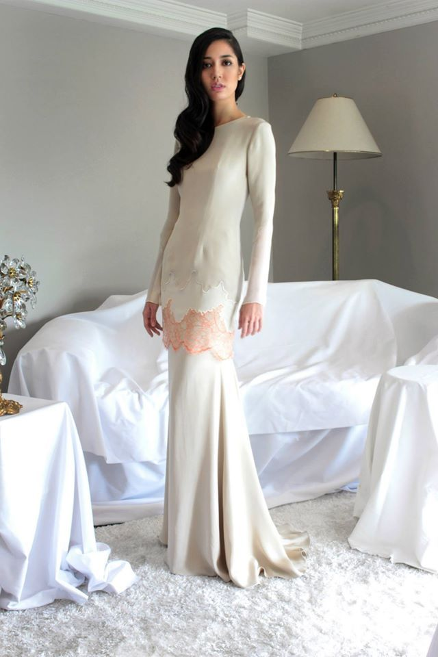 Alia Bastamam Raya 2014 Modern baju kurung in crepe silk with embroidered chiffon and lace panels. Made-to-measure only.