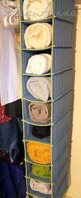 GREAT IDEA: store rolled up sweaters in shoe hanging caddy!  Or I like to put beach towels in to hang in laundry room for pool!!