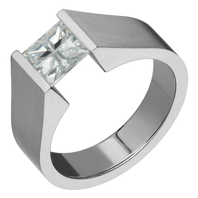 Titanium engagement ring, with cubic zirconium as an alternative to diamond.  Available at www.titaniumonline.com   Matching rings #cheap #dental #service #teeth #tooth #smile #zirconium