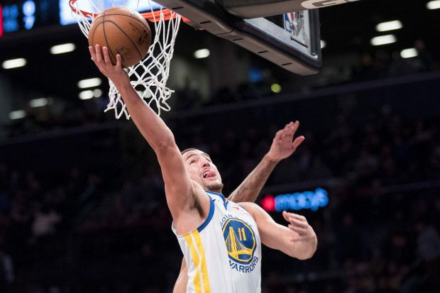 Golden State Warriors guard Klay Thompson scores during the first half of an NBA basketball game against the Brooklyn Nets, Sunday, Nov. 19, 2017, in New York. (AP Photo/Mary Altaffer)