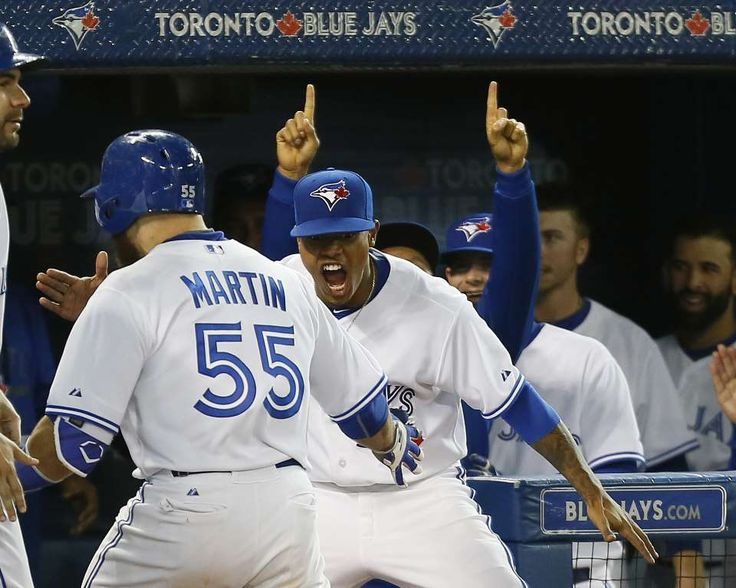 Stroman shuts out Yankees -  Toronto Blue Jays starting pitcher Marcus Stroman (6) congratulates catcher Russell Martin (55) on his three run home run in the seventh inning against the New York Yankees at Rogers Centre on Sept. 23 in Toronto, Canada. - © John E. Sokolowski/USA TODAY Sports
