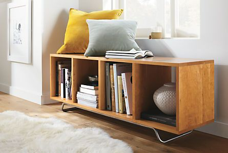 Storage and seating beautifully combine in the Ferris bench. A great solution for entryways and mudrooms, the compartments can hold baskets to contain clutter or keep shoes and boots off the floor. The solid wood frame rests on a delicate steel base.