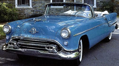 1954 Oldsmobile Ninety-Eight Holiday Convertible.......my husband learned to drive in a green one, owned by his grandfather