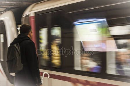 Passenger waiting for the metro at subway station - creative blurred effect on the train that is arriving – Stock Editorial Photo © carlotoffolo #147822409
