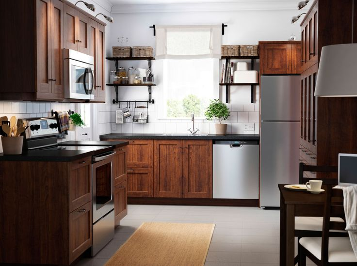 A small traditional kitchen with brown wood effect drawers, doors and open shelves with space for baskets, jars and items that you use daily.