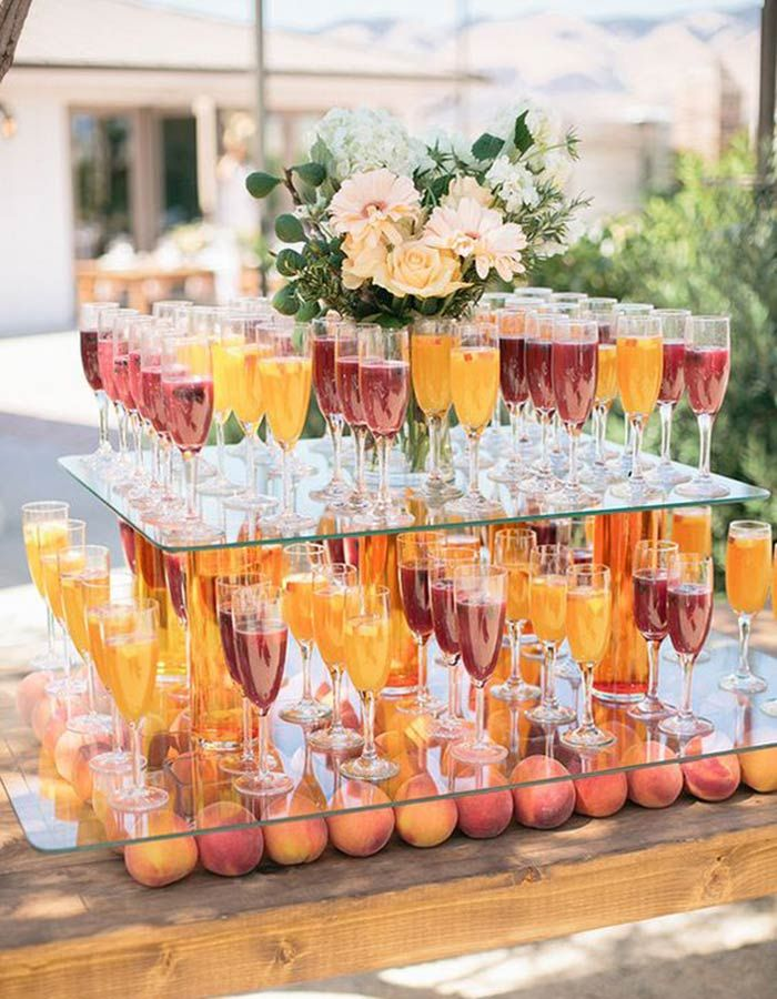 Innovative food display ideas for Indian weddings | Absolutely love this Cocktail station made with glass slabs and peaches | Indian wedding catering | Creative food display ideas | Wedding food porn | New food display trends | Source: Pinterest | Every Indian bride's Fav. Wedding E-magazine to read. Here for any marriage advice you need | www.wittyvows.com shares things no one tells brides, covers real weddings, ideas, inspirations, design trends and the right vendors, candid photographers…