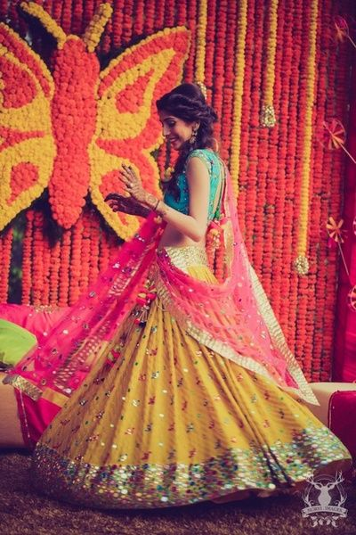 bright colorblocked lehenga in leheriya yellow pink and blue with mirror work detailing, kitsch, funky, bright, neon, summer bride, mehendi lehenga, bride spinning,