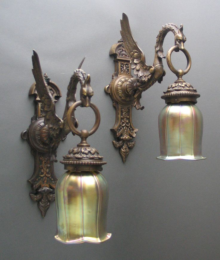 dragon sconces - I think that matte black glass would be so much cooler, but thats just me... ~ETS #dragon #sconces #vintagesconces