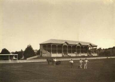 This is an 1885 photo of Adelaide Oval with cricketers and groundsmen....and their horse drawn roller in the background.