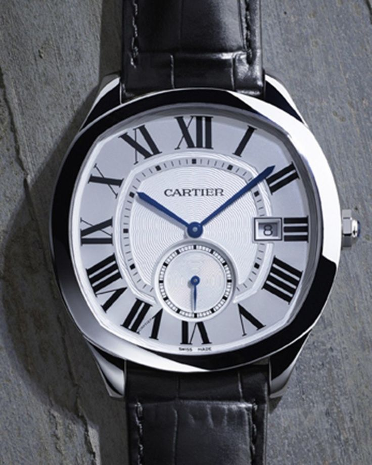 The @cartier Drive de Cartier - this watch from Cartier's new shaped men's collection, was introduced at SIHH 2016 in Geneva. Featuring a slim tapered profile, its pattern on the guilloché center is uniquely repeated on the outside of the chapter ring, adding elegance. Shown in steel. More @ http://www.watchtime.com/wristwatch-industry-news/watches/drive-de-cartier-the-new-cartier-mens-collection/ #cartier #watchtime #luxurywatch #SIHH2016