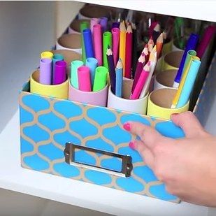 Sort your favorite coloring materials (or other office supplies) by color using a shoebox and empty toilet paper rolls. | 7 Easy Organizing Tricks You'll Actually Want To Try