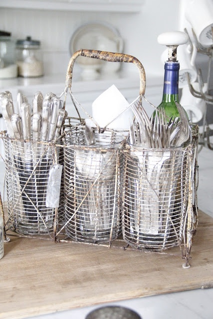 This is a unique french wire bottle carrier holding our everyday staples of hotel flatware - Wire wine bottle carrier ...