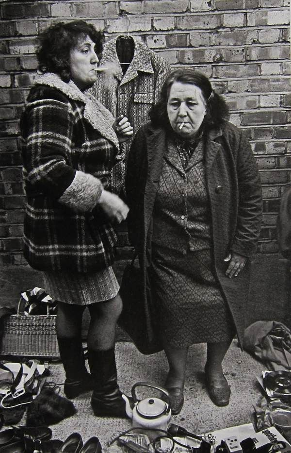 Two women with a cigarette, Cheshire St 1977, Brick Lane, London by Markéta Luskačová