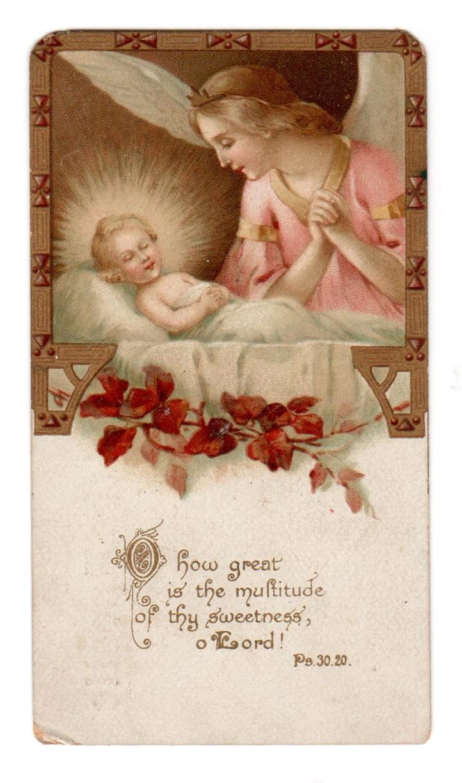 Baby Jesus with angel adoring Him