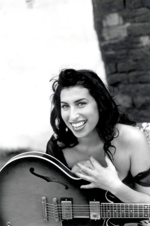 Amy Winehouse the highly talented deceased woman before the tatoos and shit kicked off