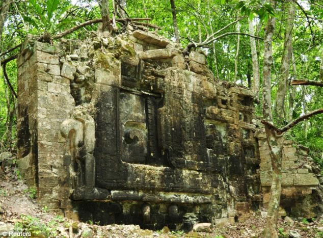 Ancient: The remains of a monument in an ancient Mayan city in Lagunita May 30, 2014 is surrounded by trees in the Mexican jungle